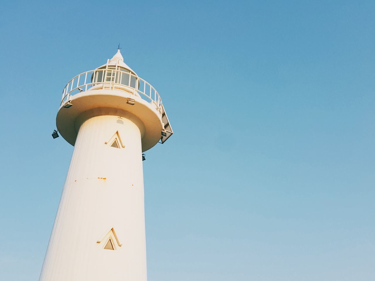 Lighthouse White Sea And Sky Lighthouse And Sky Security Protection Sky Tower Safety Low Angle View Clear Sky Day Direction Blue No People Outdoors Architecture Building Exterior Clock Face