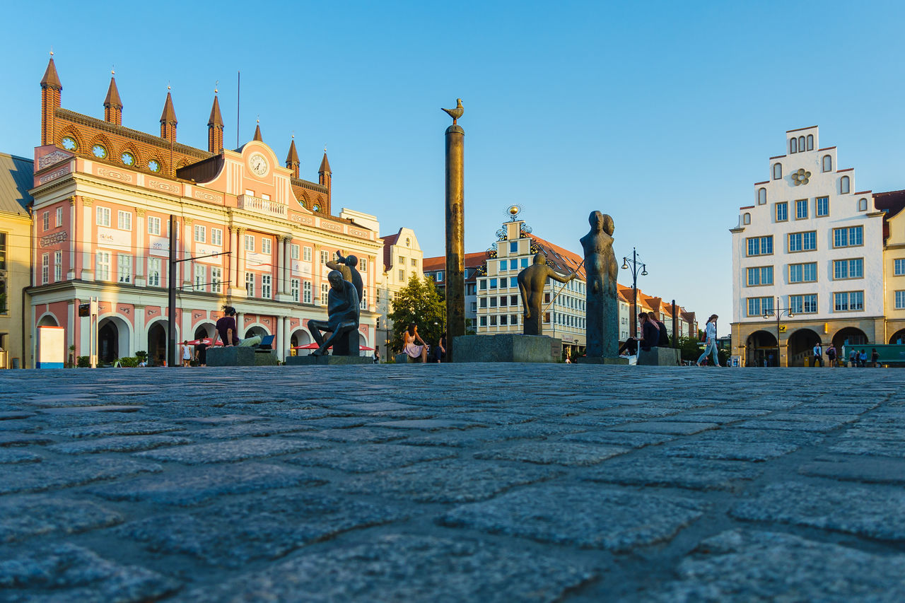 Buildings in the city Rostock, Germany. City City Hall Holiday Place Rostock Statue Architecture Building Exterior Buildings Built Structure Day Journey Landmark Neuer Markt Outdoors Sculpture Sky Tourism Town Travel Destinations Vacation