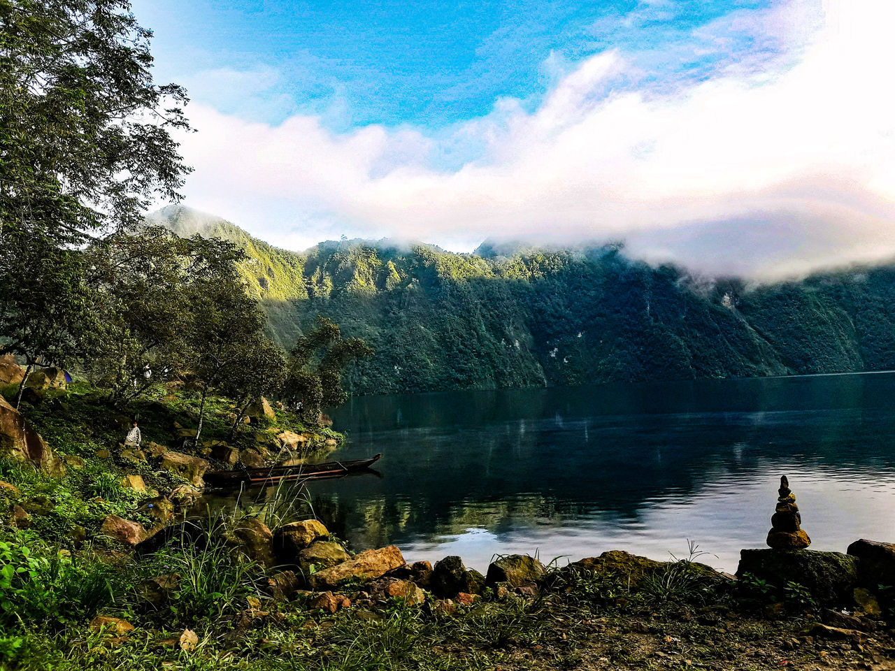 nature, tree, scenics, beauty in nature, sky, tranquil scene, tranquility, mountain, water, cloud - sky, lake, day, non-urban scene, idyllic, outdoors, no people, mountain range, landscape, growth, forest, grass