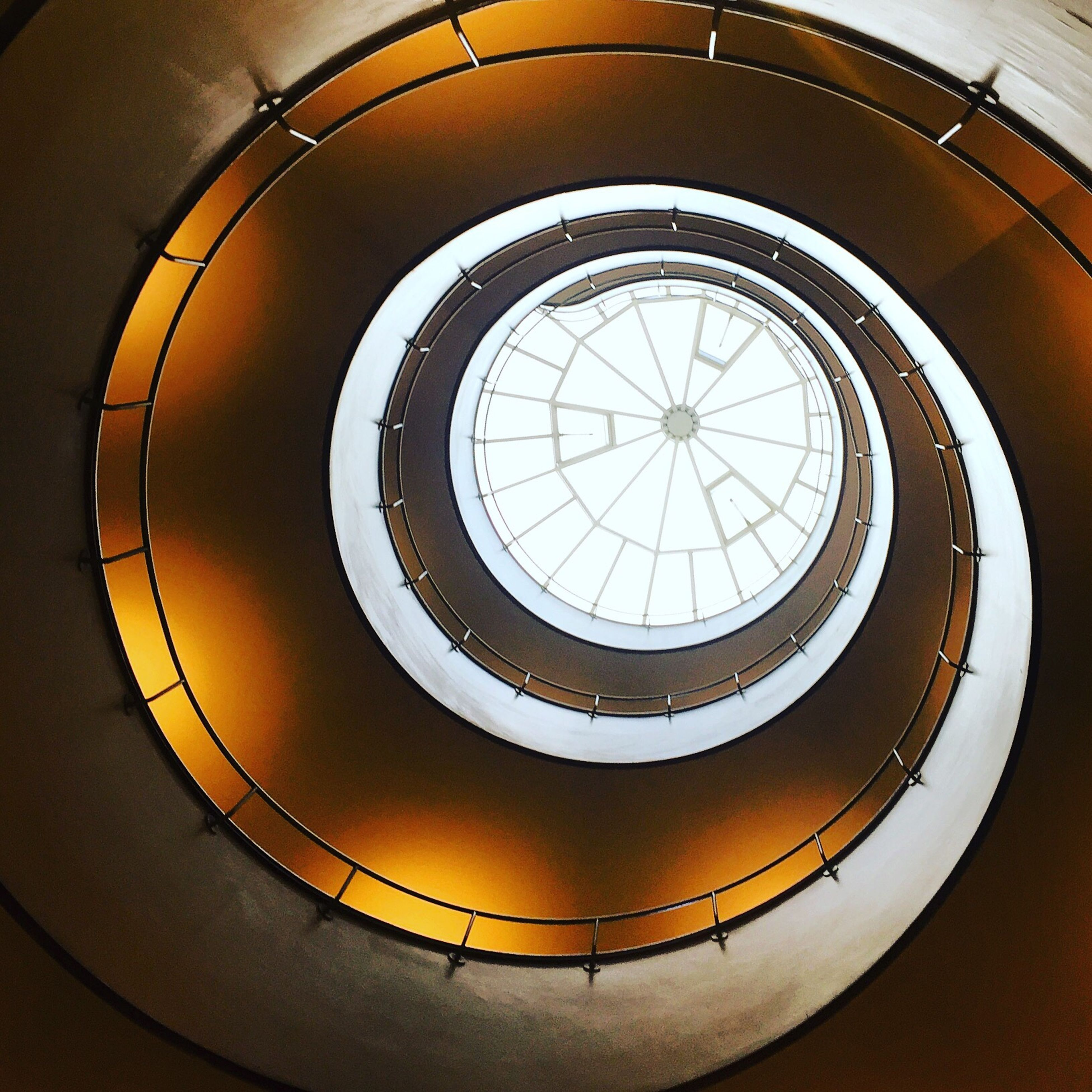 architecture, built structure, railing, staircase, spiral, no people, indoors, low angle view, steps and staircases, concentric, close-up, day