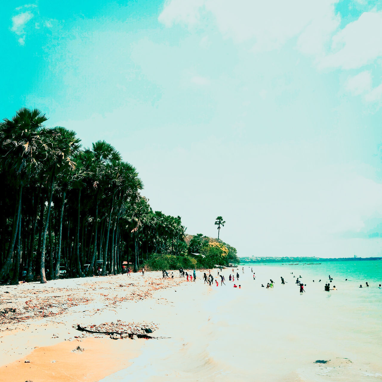 This is Batu Nona Beach. Sea Beach Water Large Group Of People Tree Vacations Horizon Over Water Lifestyles Leisure Activity Sand Tranquil Scene Enjoyment Tranquility Cloud Summer Shore Ocean Coastline Calm Sky