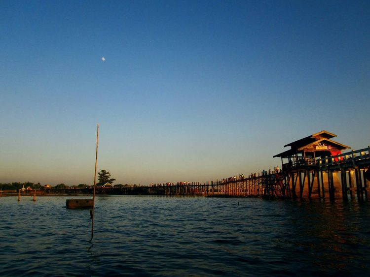 Lovely moon at U Bein Bridge The _ Mazzalong Boats⛵️ Relaxing Hello World Enjoying Life Asian Culture Myanmar View Ubeinbridge Mandalay Sunset Themoon Sky Taking Photos Myanmar Myway Asian