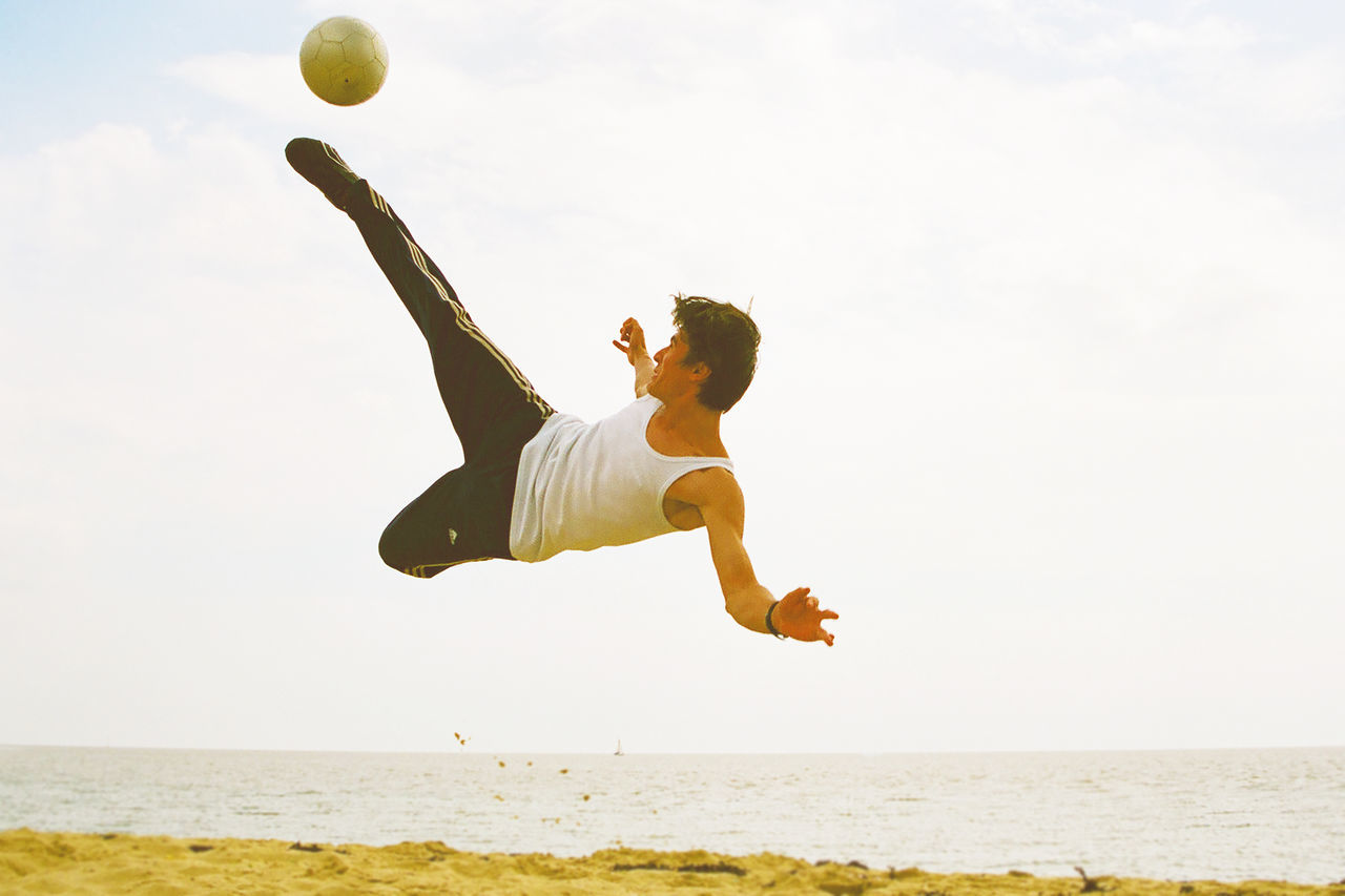 #ballislife #beach #extreme #sport #shooting #host #nature #Football #scissorkick #SoccersLife Agility Beach Day Full Length Jumping Mid-air Motion One Person Outdoors People Physical Activity Skill  Sport Sports Clothing