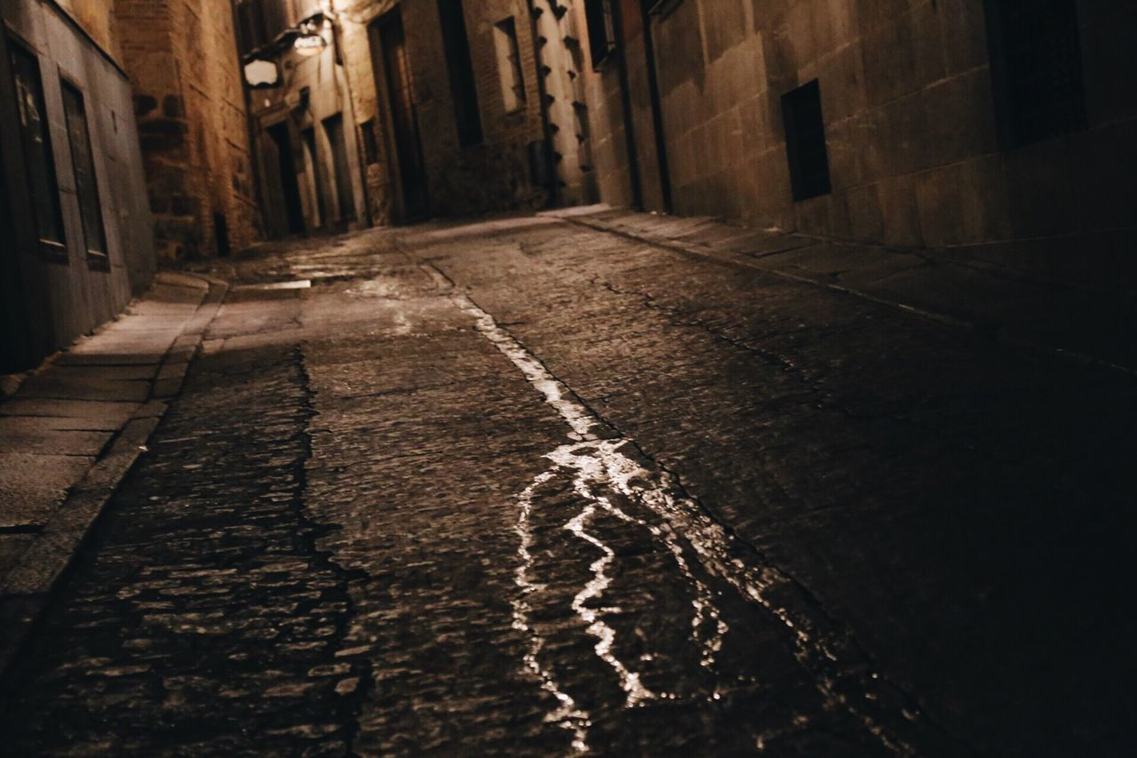 Finding New Frontiers No People Outdoors Architecture Day Water Built Structure Mysterious Mystical Night Nightlife Night View City Backroads Backstreet Pouring Water Monochrome Monochrome Photography