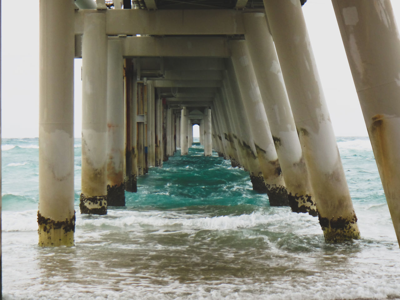 Architectural Column Architecture Beach Beauty In Nature Built Structure Day Horizon Over Water Nature No People Outdoors Pier Sea Sky Underneath Water Wave