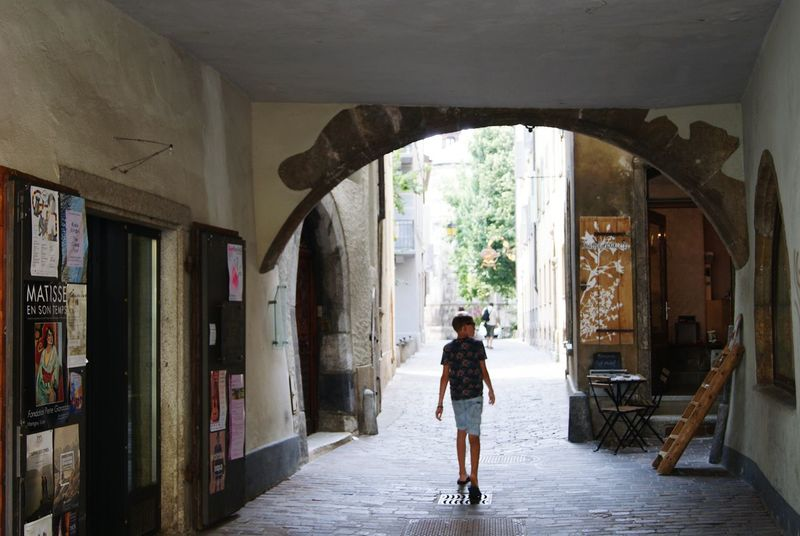 Street Photography Streetphotography Streetphoto Old Old Buildings Old Town Switzerland Small Street Shop Matisse Archway Archways Archway Over Road Old Path Old Road Alley Walking Around The City  Walking Around Boy Curious Exploring Explorer Peoplephotography