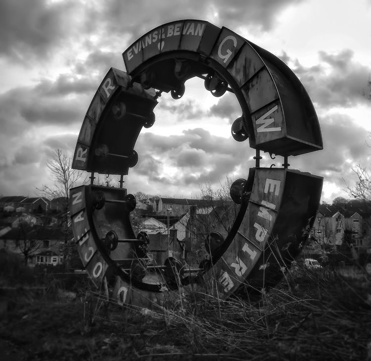 Wheel o Drams known locally as the Stargate a unusual piece of Modern Art formed from the Circle of coal mining dram trucks Architecture Fujifilm Outdoor Photography Bnw_captures Monochrome Photography Black And White Portrait Black And White Photography Malephotographerofthemonth Creative Light And Shadow No People Portrait Coal Mining History Coal Transportation Welsh Valleys Old Equipment Mining Heritage Mining Village