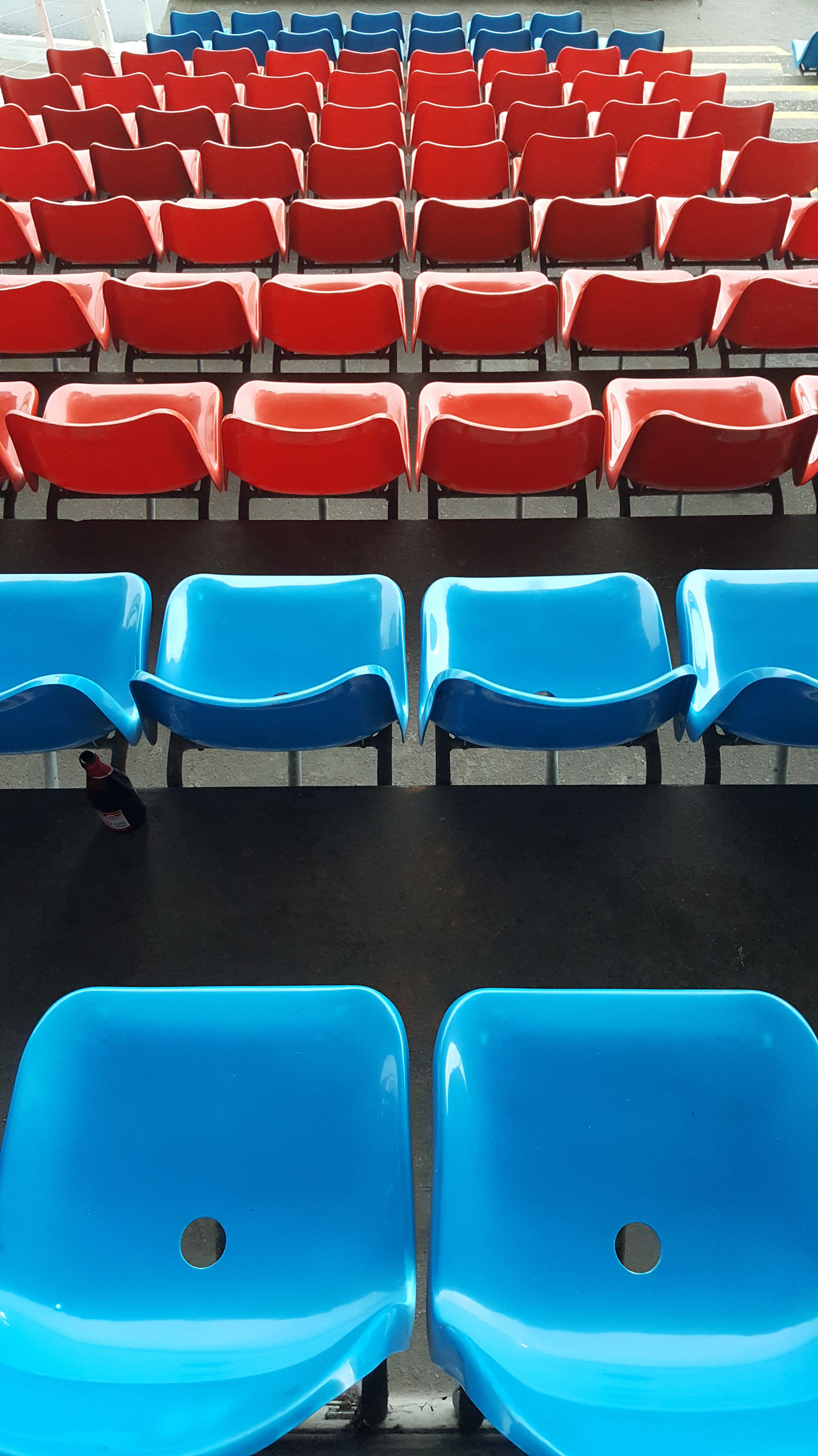 Leopardstown Racecourse Absence Blue Chair Empty In A Row No People Plastic Seating Red Seat