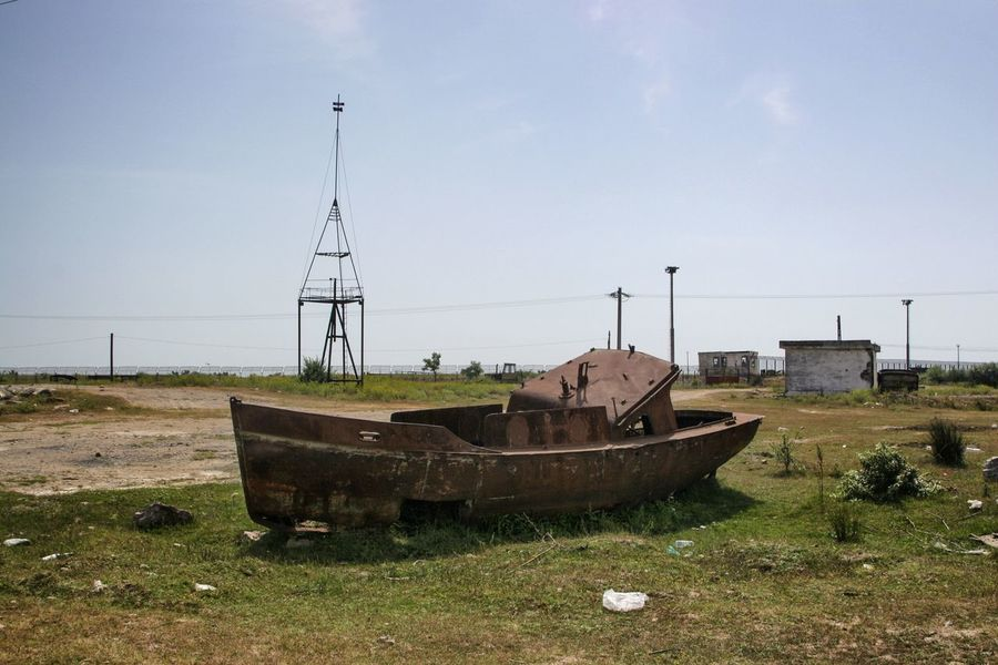 DanubeDelta Sulina WreckedShip Abandoned Boat Damaged Field Landscape Nature Nautical Vessel No People Outdoors Rusty Sky Transportation Wrecked Wrecked Boat.