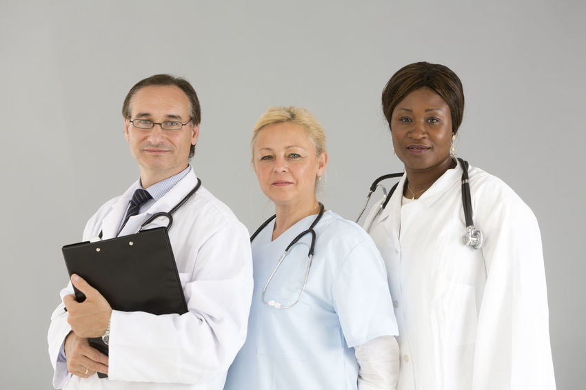 Front View Medical Team Man With Glasses Holding Person Occupation Standing Real People Medical Portrait Doctor  Reassurance Stethoscope  Reassuring Clipboard Smiling Women Nurse Posing Looking At Camera Looking To The Camera The Portraitist - 2017 EyeEm Awards