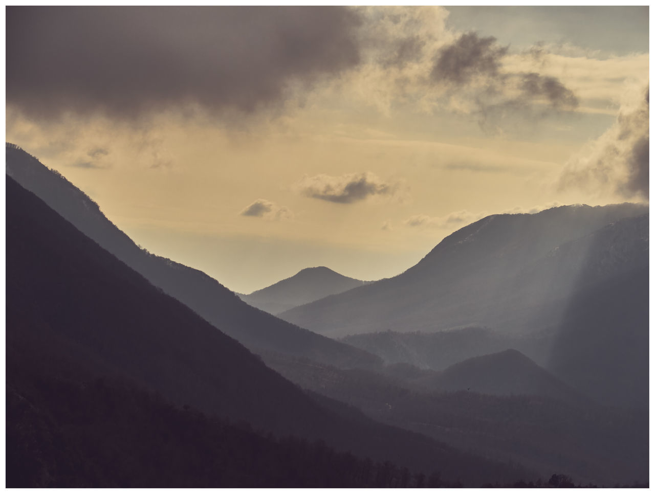 mountain, beauty in nature, nature, mountain range, tranquility, sky, tranquil scene, no people, landscape, outdoors, scenics, day