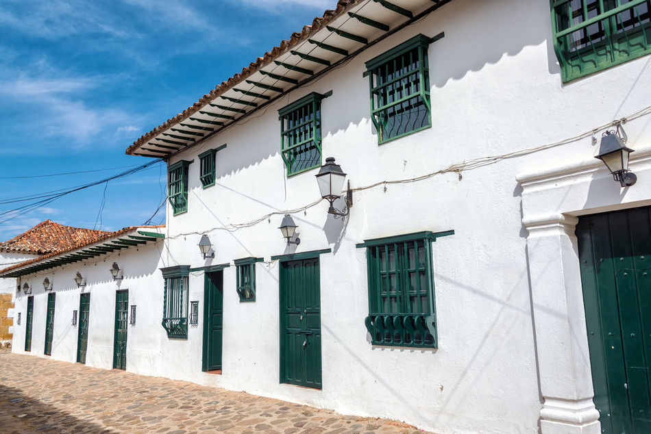 View of a white colonial street in Villa de Leyva, Colombia Architecture Building Colombia Colonial Different Exterior Green Historic Home House Latin Old Outdoors Residence Size Stone Style Town Travel Typical Villa De Leyva  Wall Window Windows Wood