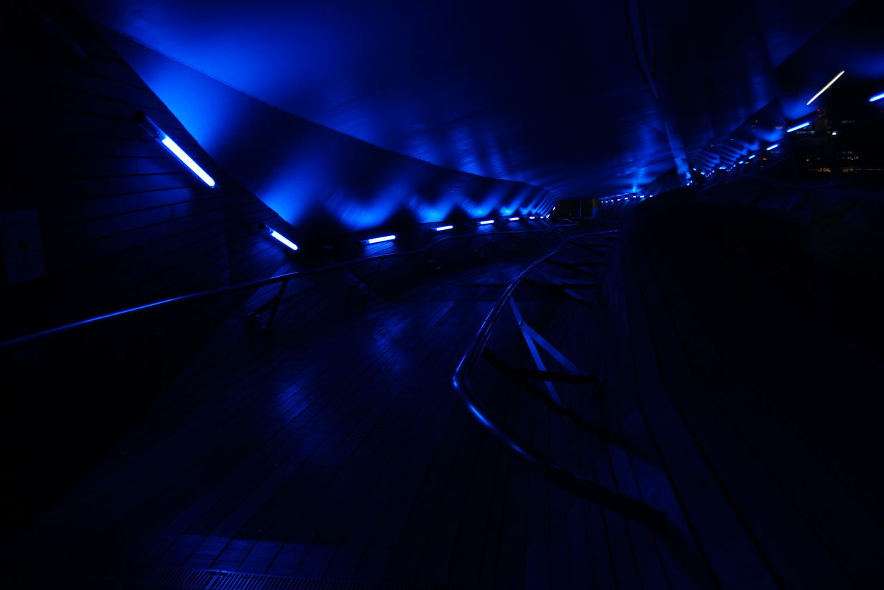 illuminated, the way forward, night, tunnel, indoors, blue, built structure, architecture, no people