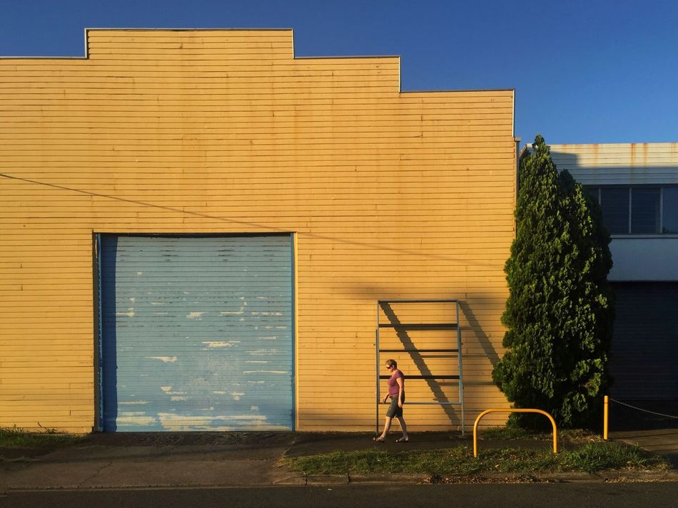 Building Exterior Built Structure Architecture Outdoors One Person Day Tree Sky People Streetphotography Yellow Streetphoto_color