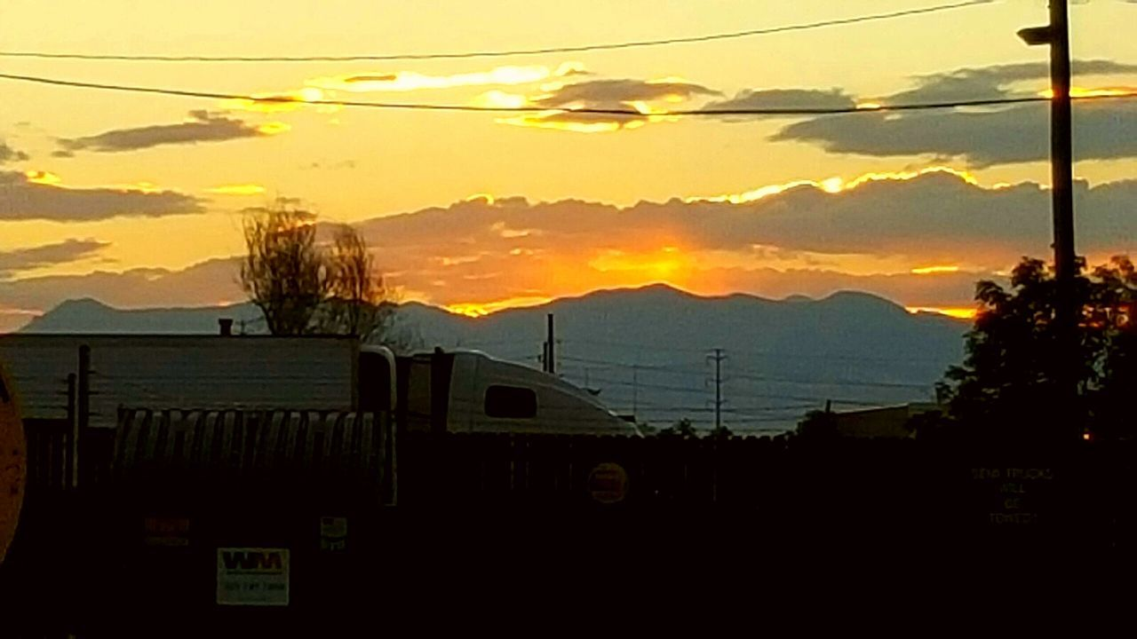 Sunset in Denver Mountains And Sky Nature Traveling TruckStop