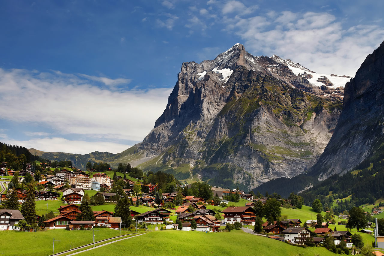 Grindelwald Village By Bernese Oberland Against Sky At Swiss Alps
