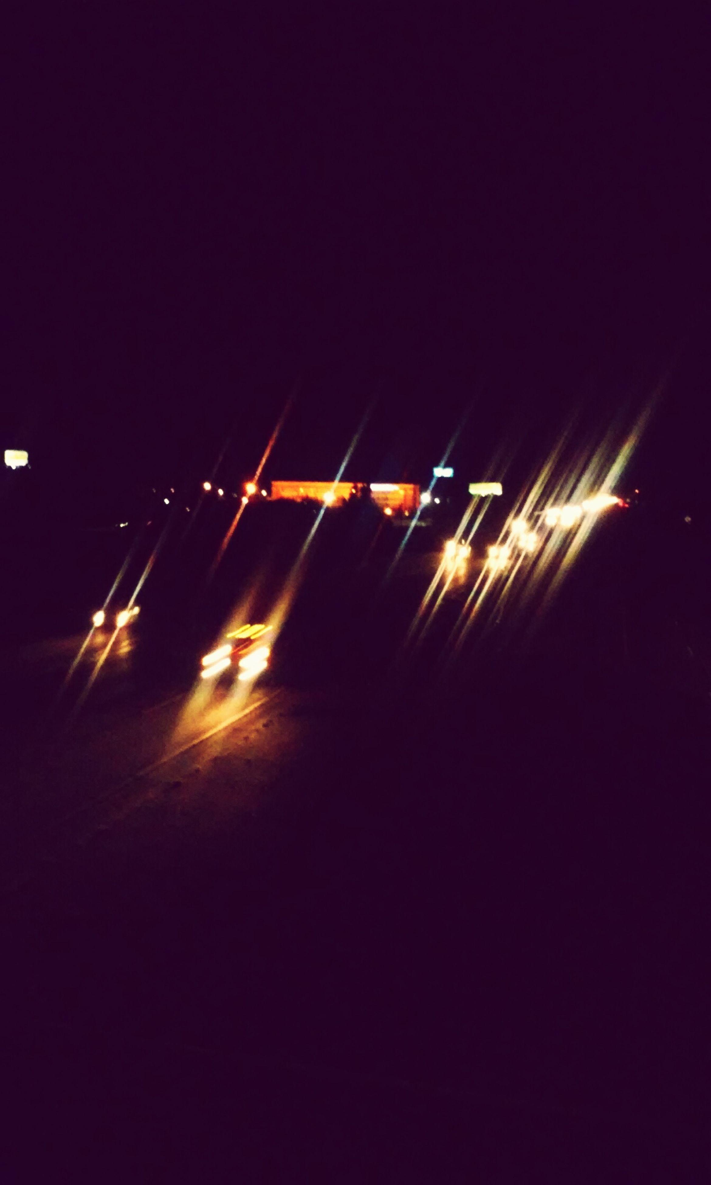 illuminated, night, long exposure, lighting equipment, motion, blurred motion, light trail, glowing, dark, outdoors, light beam, event, firework - man made object, tail light