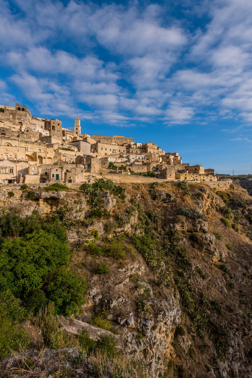 Buildings At Sassi Di Matera Against Cloudy Sky