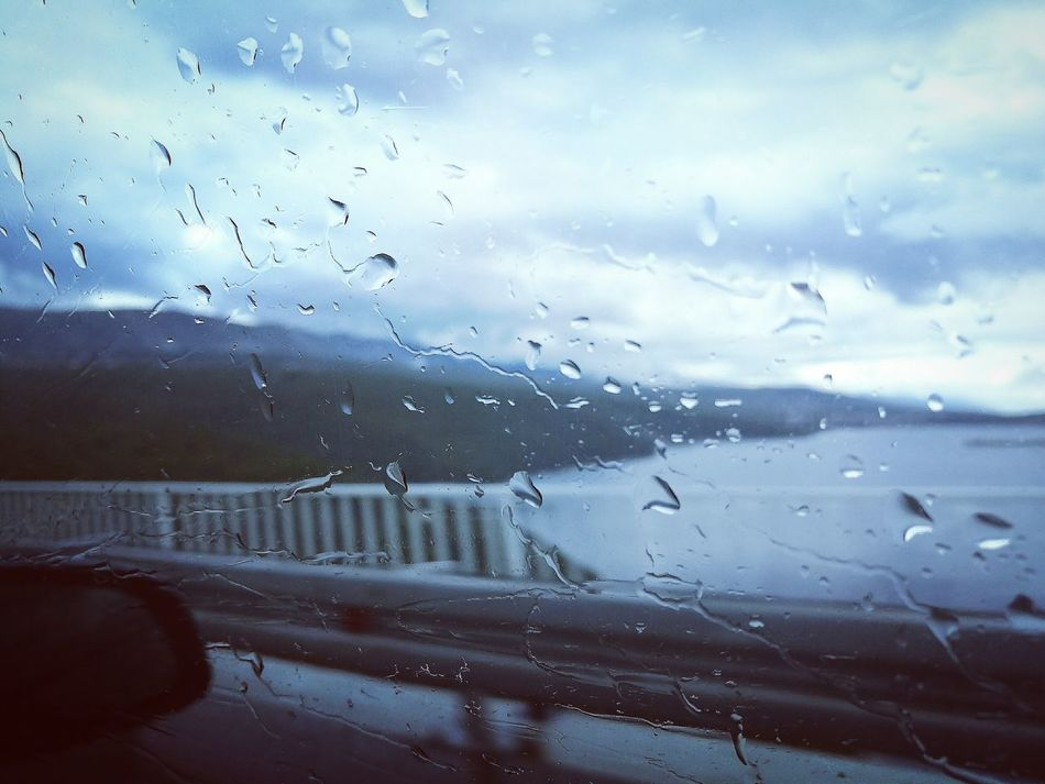 isn't raining men...just Rain ☺ Rainy Season RainDrop Wet Window Art Sky Car Weather Sea And Sky Sea View Bridge Transportation Bridge View Rainymood Wet Window Weather Drops Of Rain Mode Of Travel No People Transparent Close Up