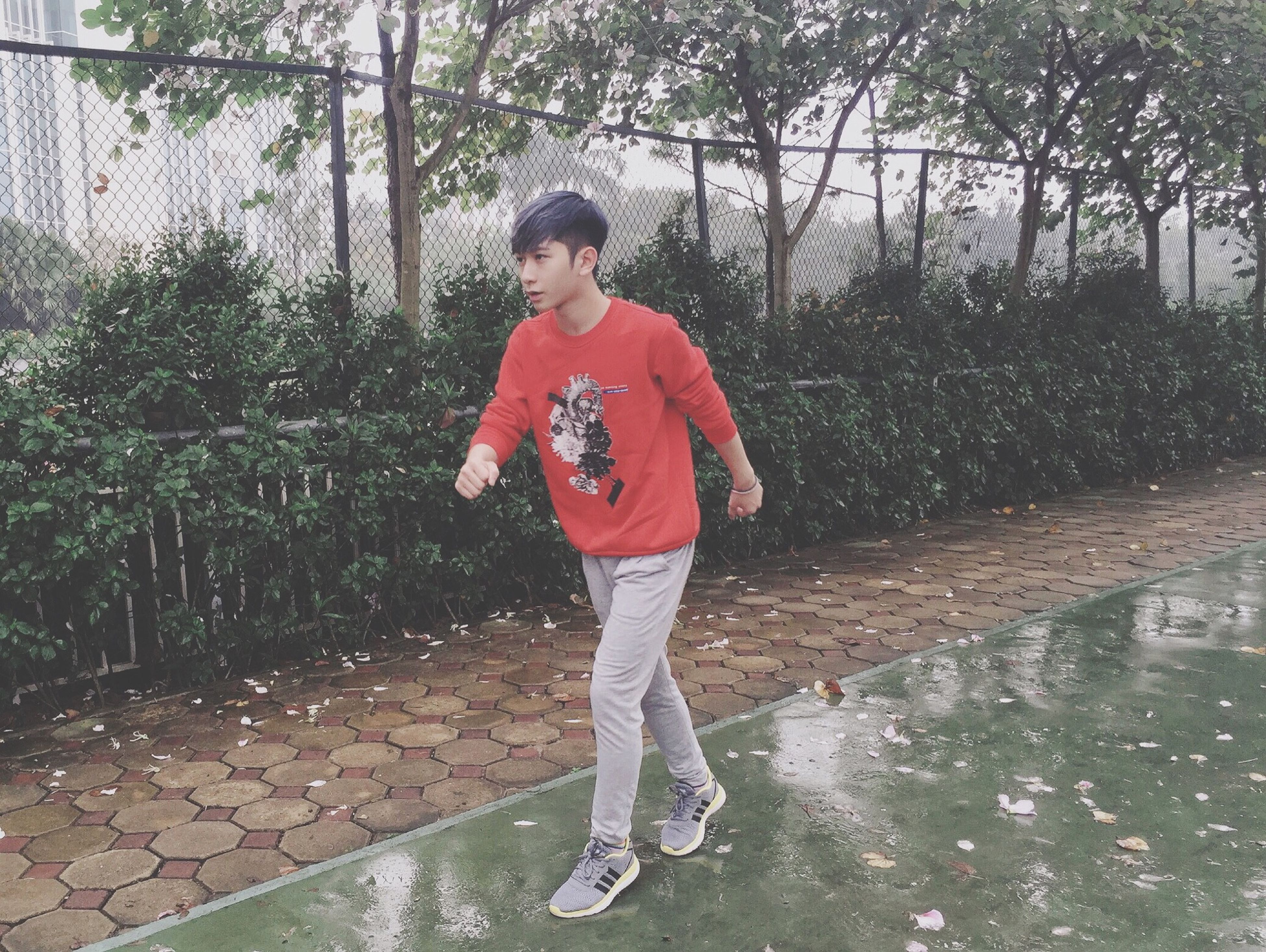 full length, childhood, person, elementary age, lifestyles, casual clothing, water, leisure activity, boys, girls, standing, innocence, tree, happiness, front view, cute, day, looking at camera