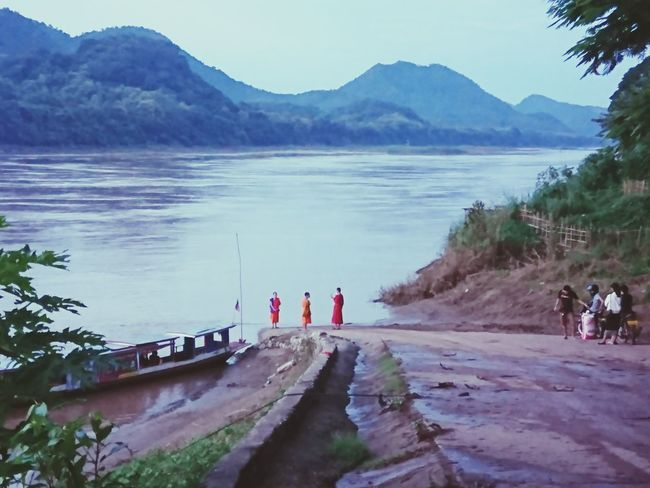 Mekong River, Luang Prabang Water Mountain Lake Small Group Of People Landscape People Outdoors Nature Mekong River Mekong Delta Adventure Laos2017 Mekongriver Laos Travel Luang Prabang, Laos Laos, Lao Trip Luangprabang Munks Weather Travel Amazing Travel Destinations Beauty In Nature