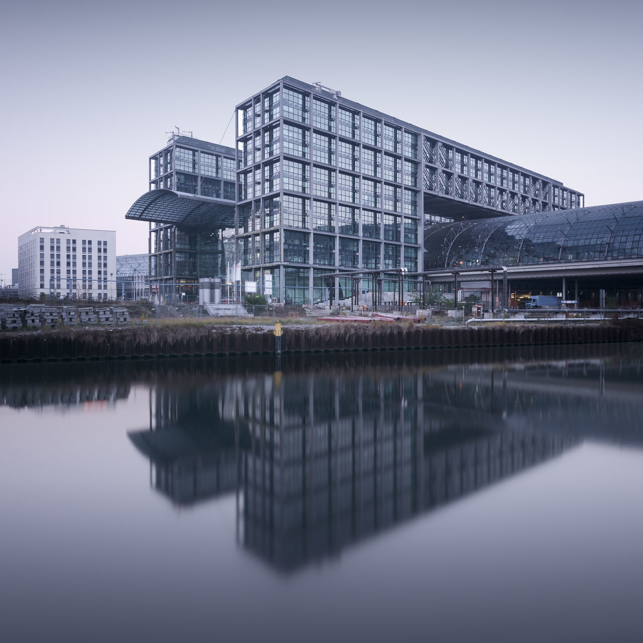 Berlin Central-Station at sunrise Architecture Beauty In Nature Berlin Building Exterior Built Structure Central Station Berlin City Clinical Atmosphere Day Fine Art Photography Germany Hauptbahnhof Longexposure Modern Modern Architecture Muted Colors No People Outdoors Philipp Dase Reflection Reflections In The Water Skyscraper Subtle Colors Water Waterfront