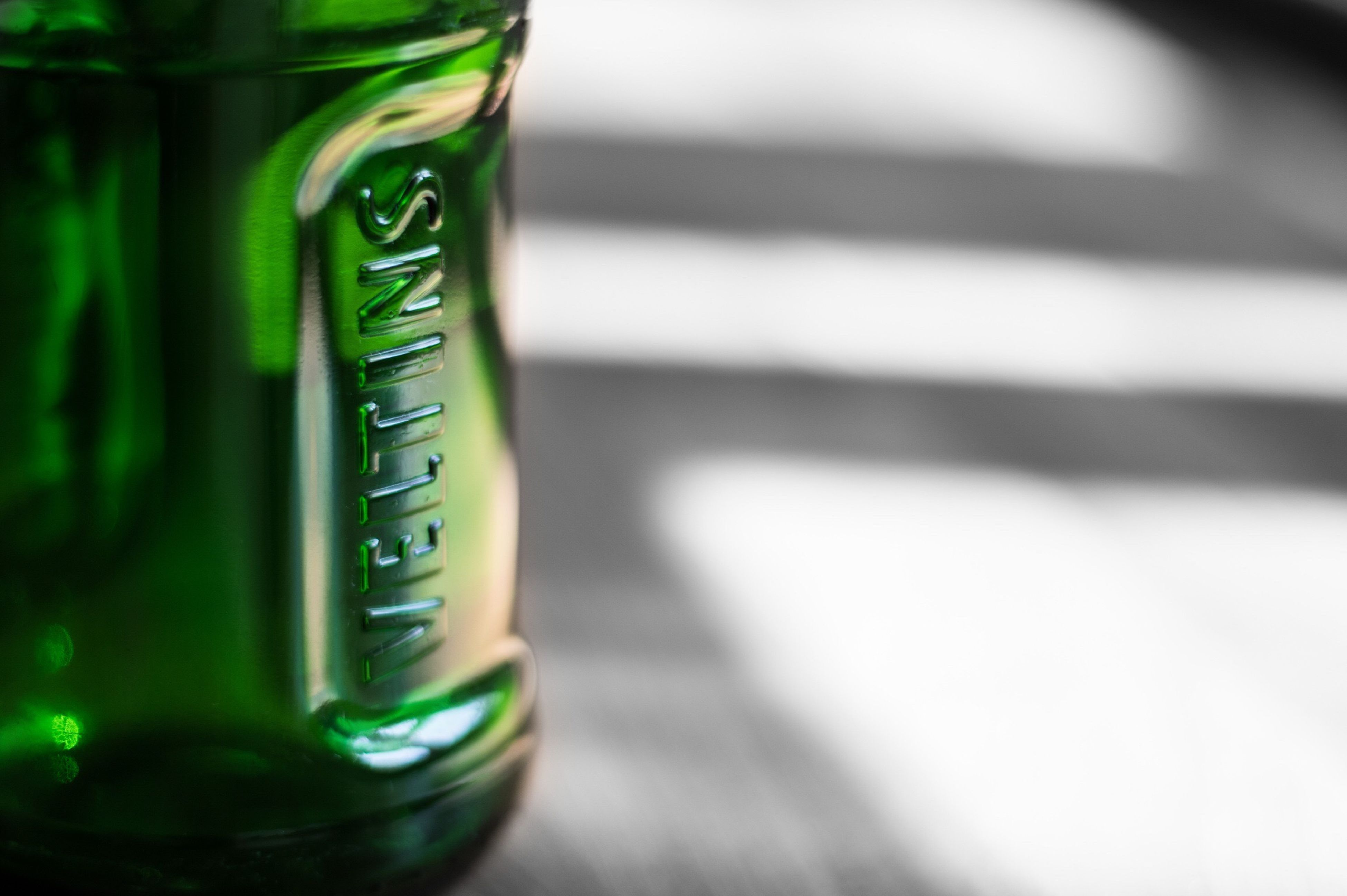 focus on foreground, close-up, still life, single object, indoors, selective focus, communication, text, container, green color, no people, freshness, man made object