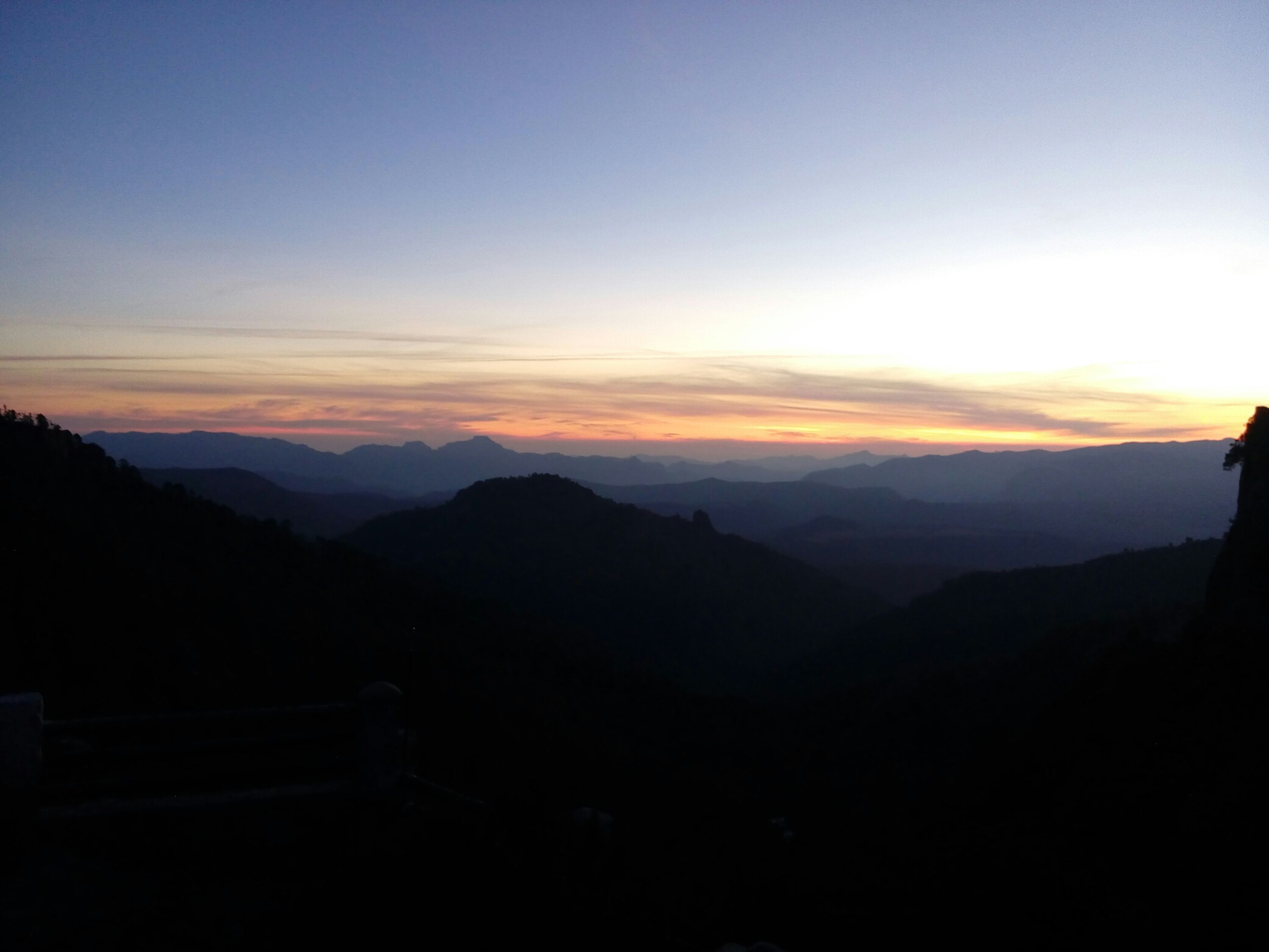 sunset, silhouette, mountain, scenics, tranquil scene, tranquility, mountain range, beauty in nature, sky, landscape, orange color, idyllic, nature, dusk, copy space, dark, non-urban scene, majestic, outline, outdoors