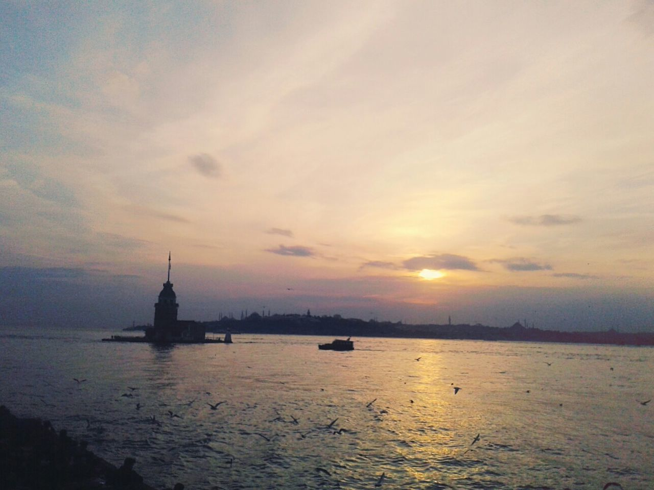 Sunset Sea Water Sky No People Travel Destinations City Cloud - Sky Outdoors Beach Nature Maiden Tower Tower Seagulls