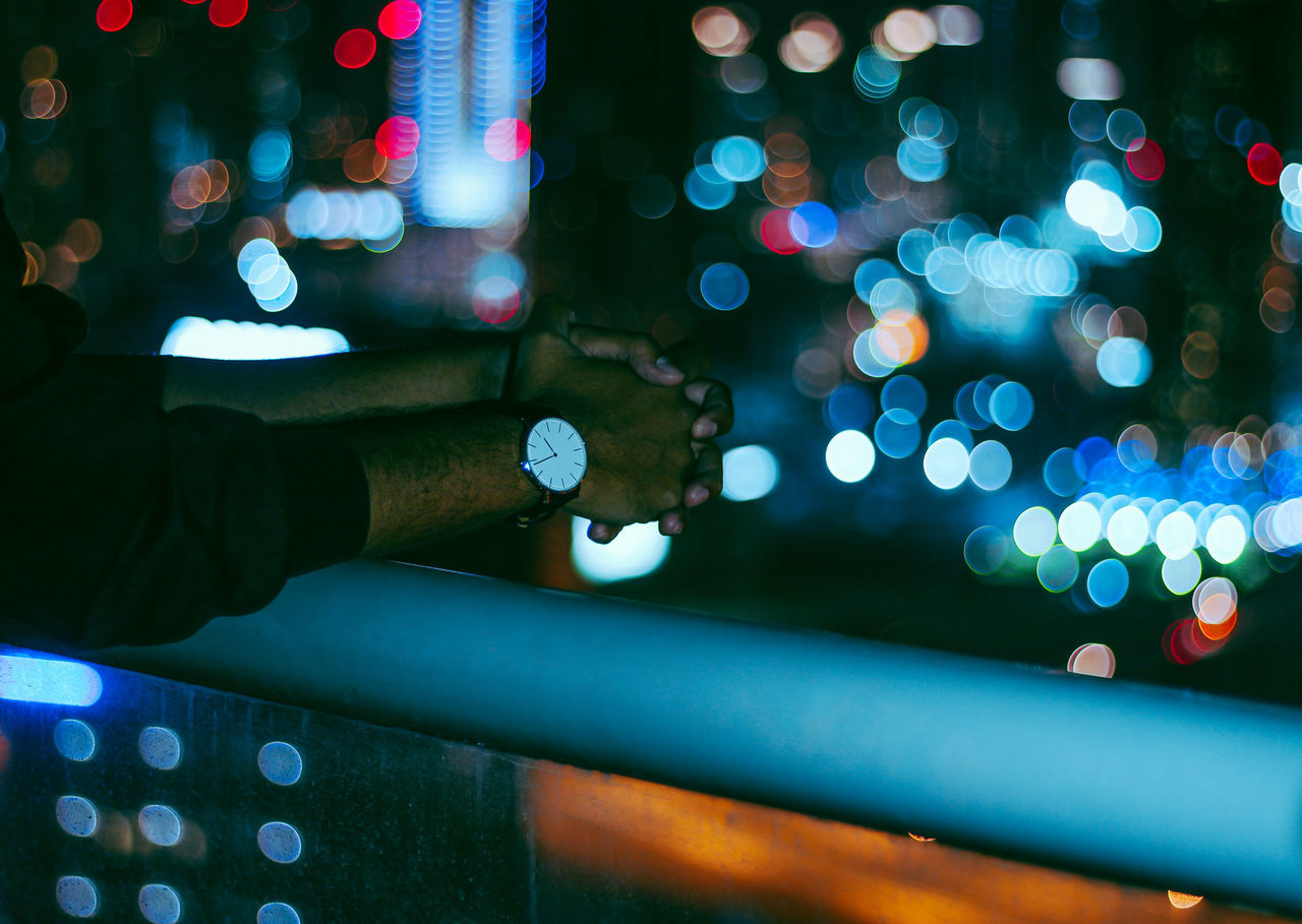 Adult Adults Only AMPt_community Bokeh Bokeh Photography City City Life Clock Close-up Colorful Colors Hand Human Body Part Human Hand Illuminated Night One Man Only One Person Only Men Outdoors People Real People Shootermag Urban