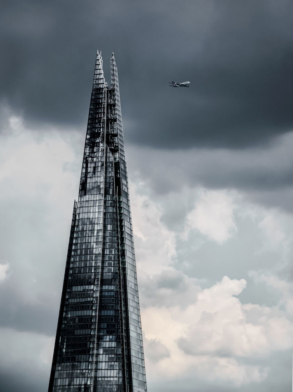 Airplane Architecture Building Exterior Built Structure Cloud - Sky Commercial Airplane Low Angle View Modern Sky Skyscraper Tall The Shard, London Tower