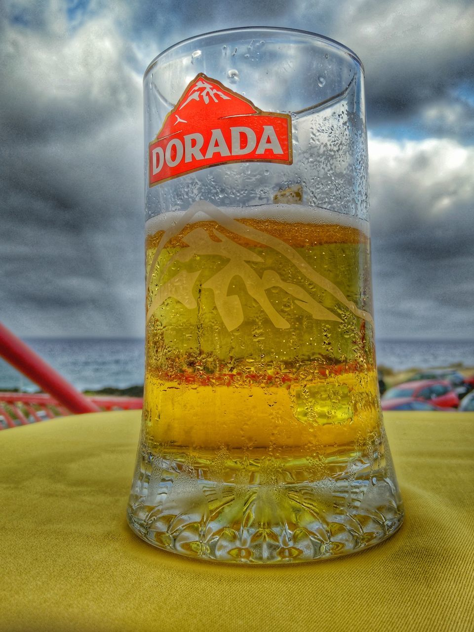 food and drink, drink, freshness, still life, refreshment, text, no people, close-up, table, drinking glass, yellow, jar, cloud - sky, food, day, indoors, healthy eating, water, sky