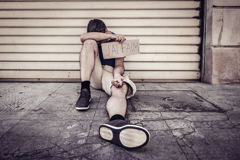 Adult Beggar Begging Cardboard Day France Franch Full Length Homeless Hunger J'ai Faim One Person Outdoors People Poverty Poverty Lives. Real People Sitting Social Issues Text Young Adult