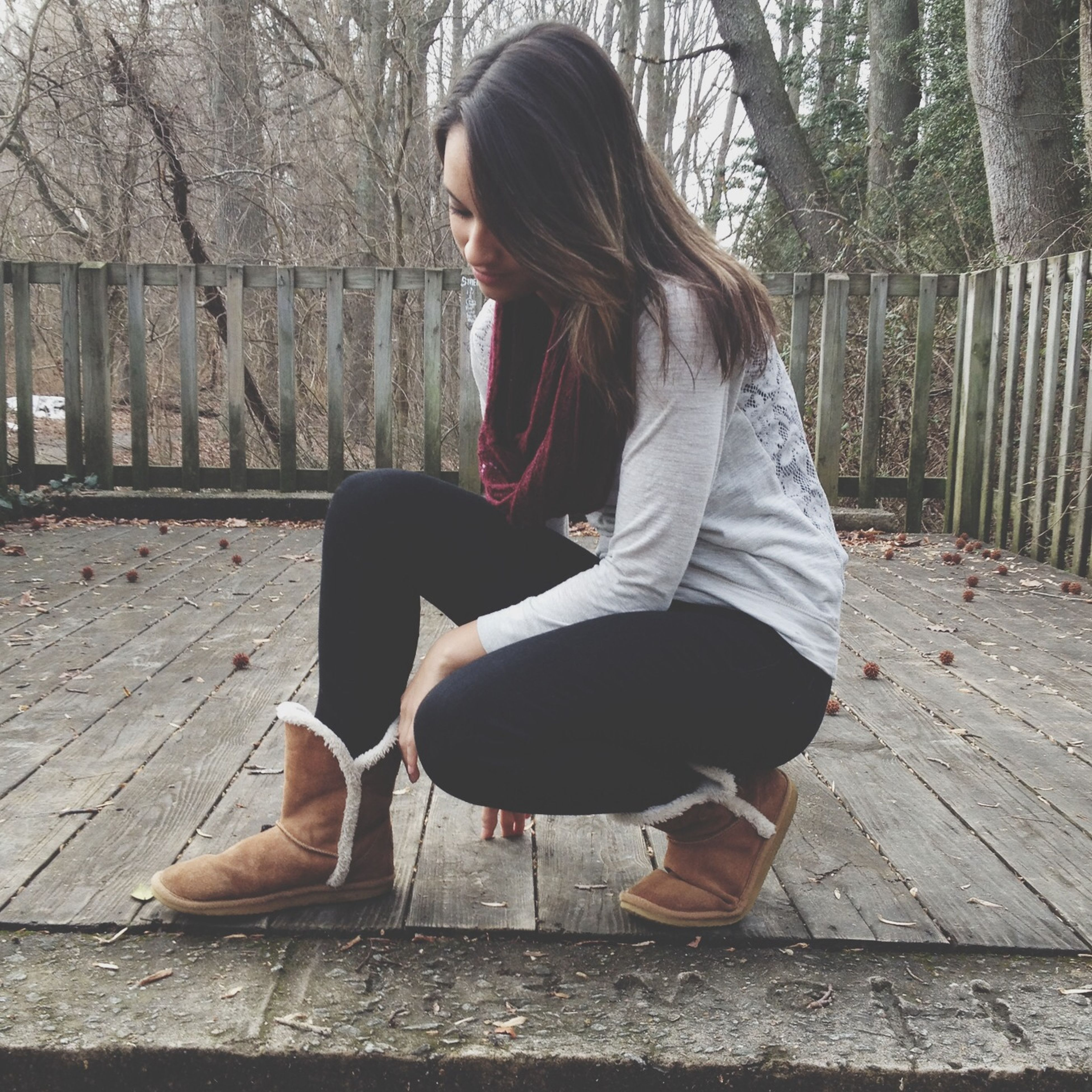 lifestyles, casual clothing, leisure activity, young adult, full length, young women, person, sitting, long hair, standing, side view, three quarter length, tree, rear view, relaxation, day, jacket, outdoors