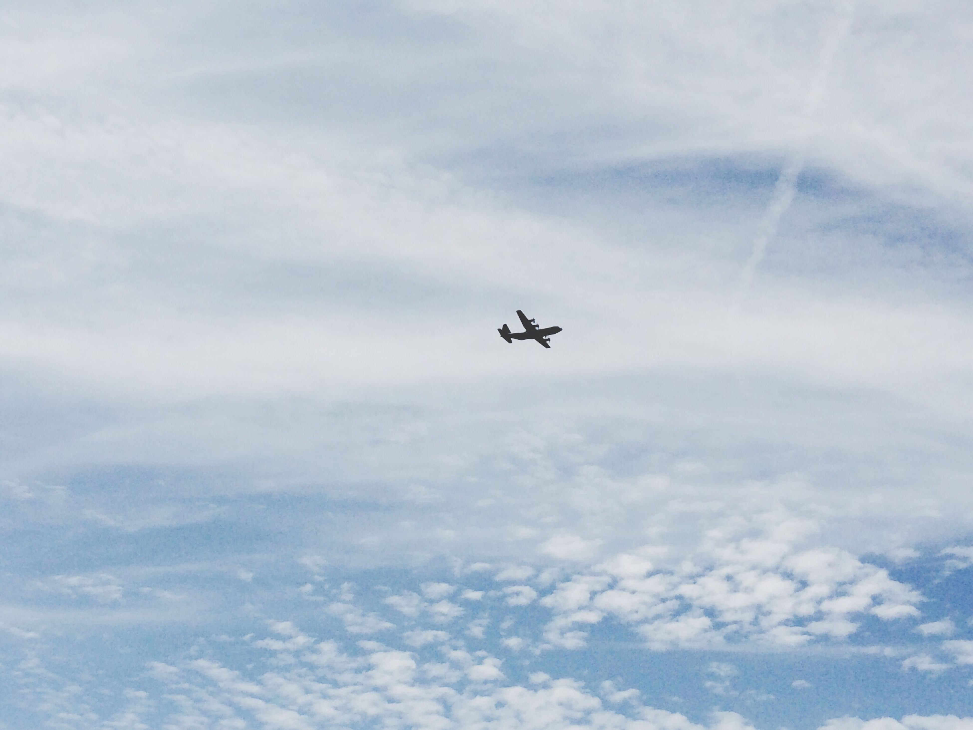 airplane, air vehicle, transportation, flying, mode of transport, mid-air, sky, low angle view, cloud - sky, on the move, travel, journey, public transportation, commercial airplane, cloud, helicopter, nature, cloudy, day, aircraft wing