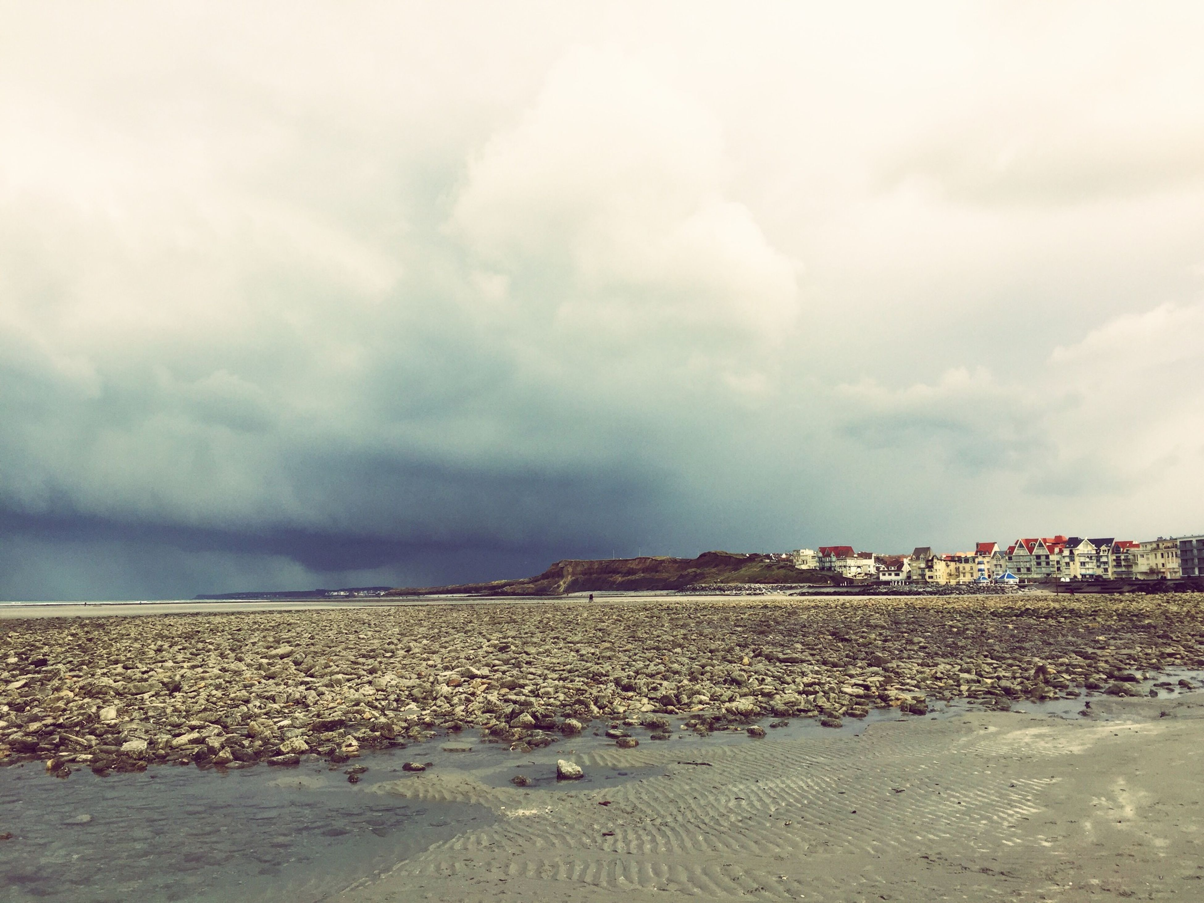 sky, cloud - sky, cloudy, building exterior, built structure, architecture, overcast, cloud, weather, house, landscape, tranquility, day, tranquil scene, nature, beach, outdoors, sand, no people, scenics