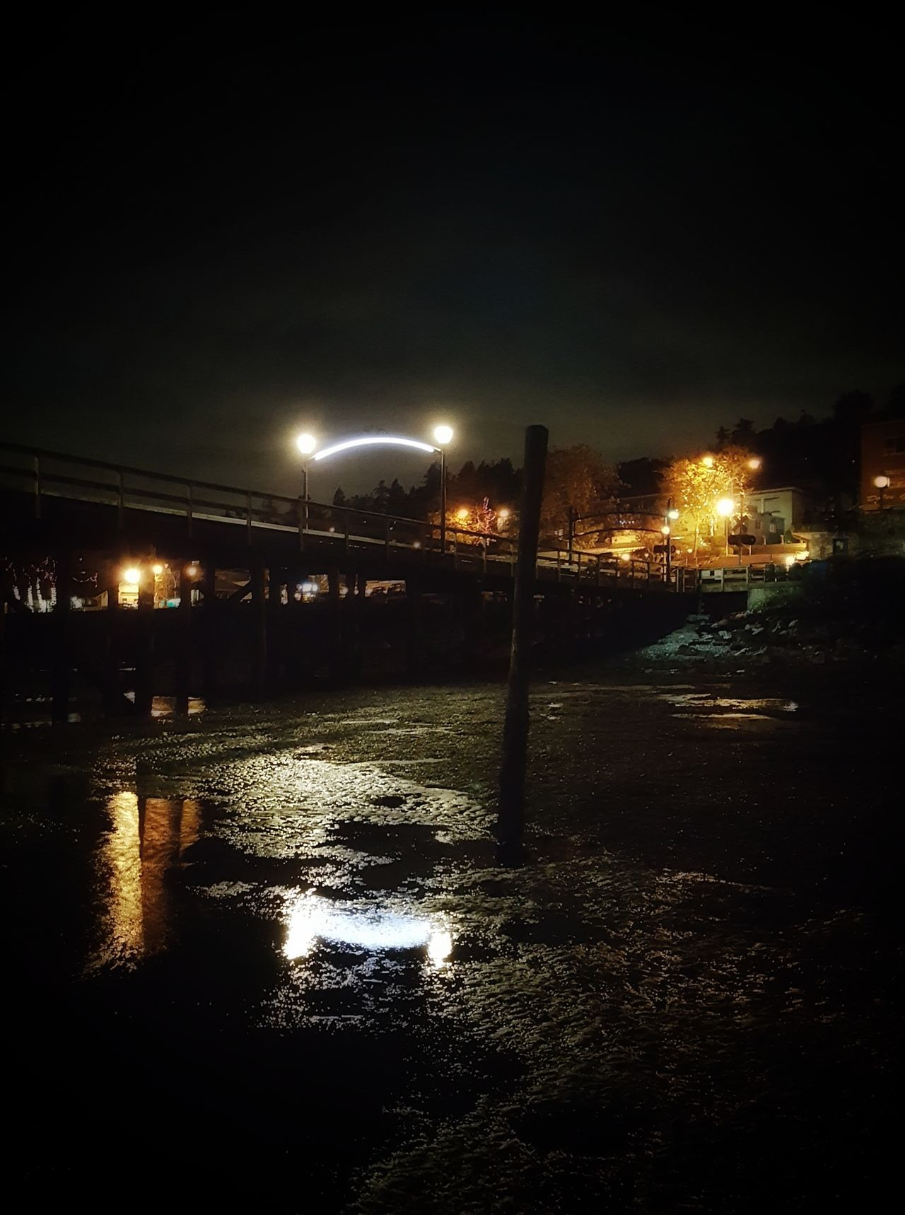 Illuminated Night Street Light Lighting Equipment Reflection Street Water Road Lamp Post Outdoors Sky Tranquility No People Bridge Scenics Tranquil Scene Non-urban Scene Atmosphere Atmospheric Mood Electric Light Cloud Reflection Street Light Architecture Waterfront