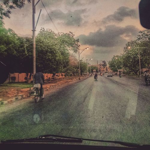 The Road Less Traveled Front View Drivebyphotography NatureandPeople Skyandcity Photography In Motion Photography Is My Escape From Reality! Karachi Pakistan Pakistan Amongstthepeople Instacityscapes Cityroads Cloudsandcityscapes