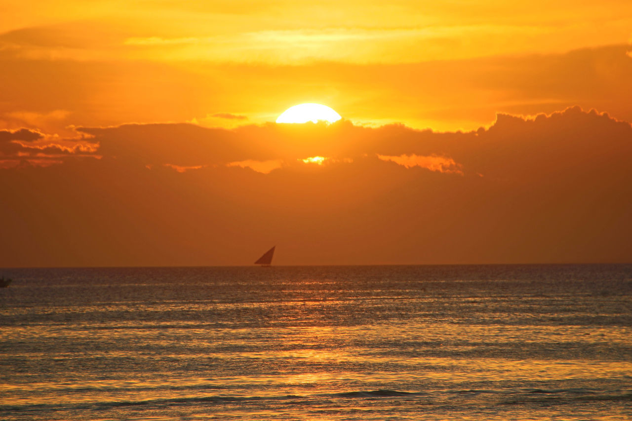 Cloudy Sunset in Zanzibar Beauty In Nature Day Nature No People Outdoors Scenics Sea Serene Tranquil Outdoors Sky Sun Sunlight Sunset Water Yachting