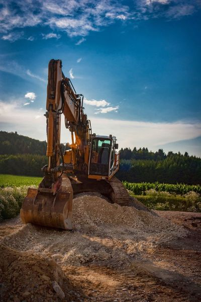 Construction Machinery Construction Site Earth Mover Machinery Landscape No People Outdoors Sky Day Excuvator