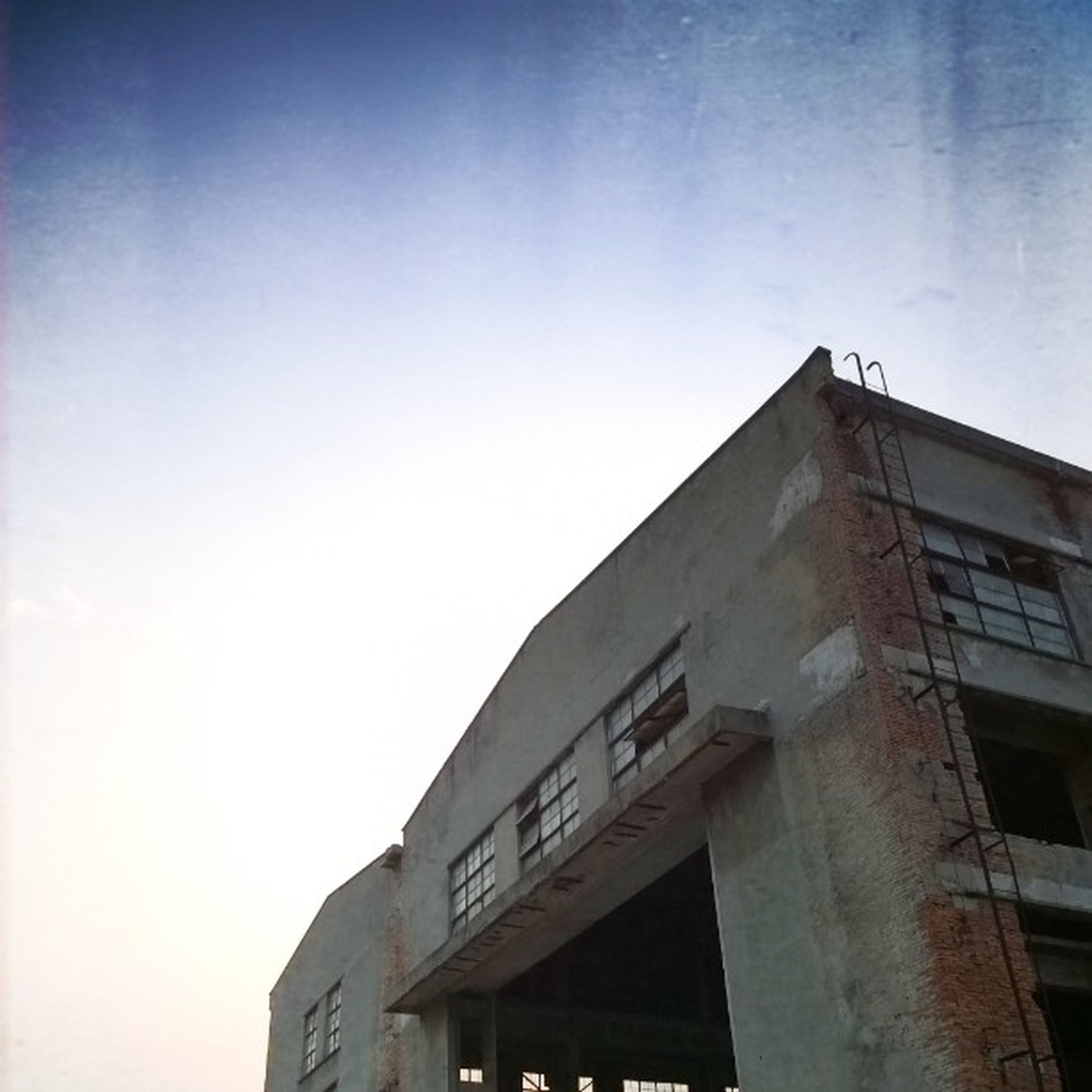 architecture, building exterior, built structure, low angle view, clear sky, window, building, residential building, residential structure, copy space, city, sky, high section, outdoors, day, no people, house, blue, balcony, apartment