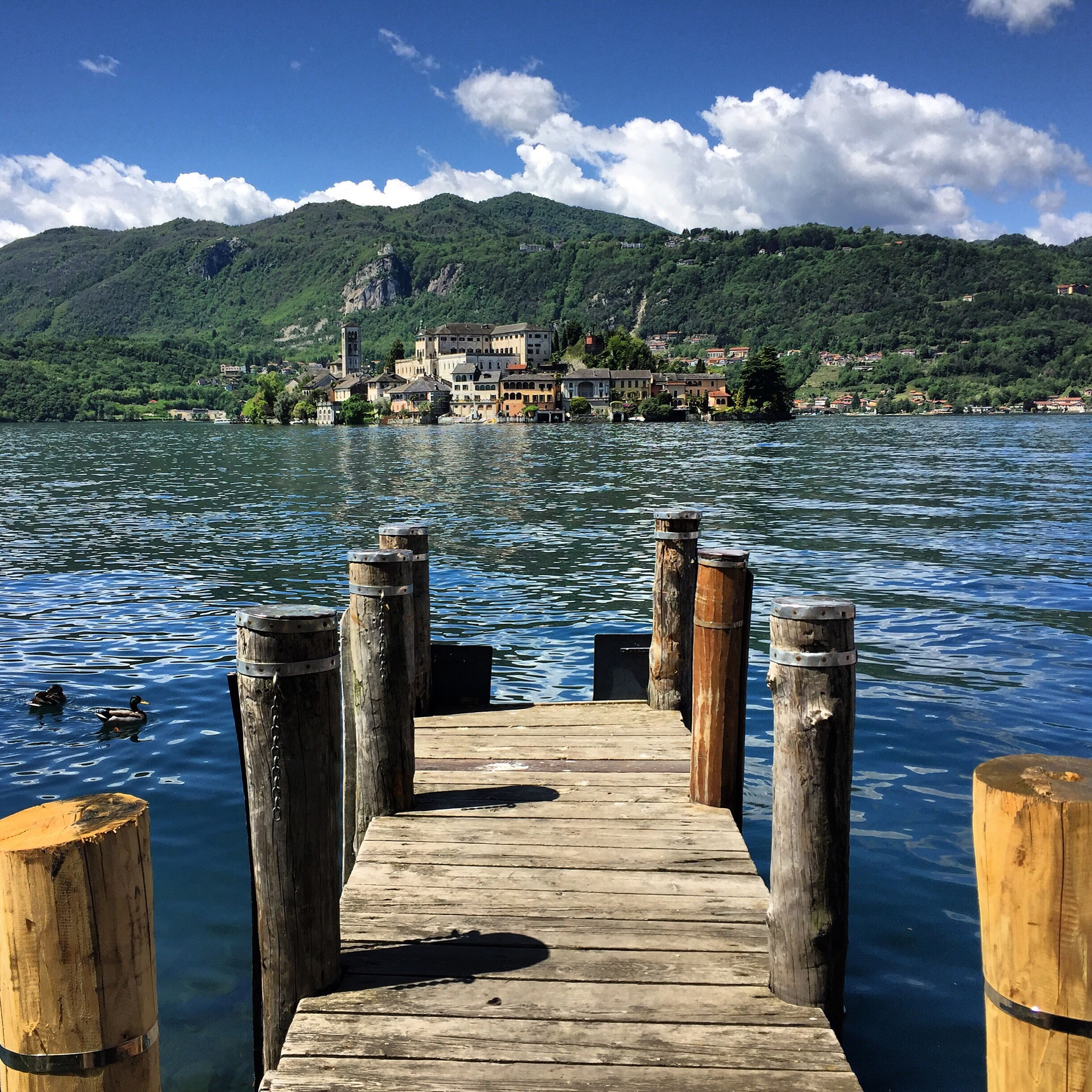 water, mountain, sky, pier, blue, tranquil scene, built structure, tranquility, wood - material, lake, the way forward, scenics, jetty, beauty in nature, architecture, cloud, nature, wood, mountain range, cloud - sky