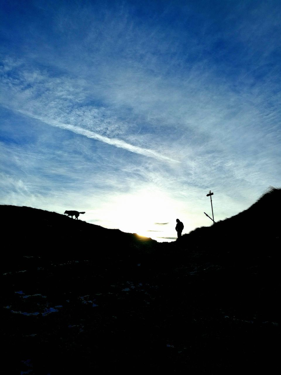 silhouette, one person, sky, leisure activity, real people, men, sunset, outdoors, sunlight, sun, lifestyles, nature, standing, day, beauty in nature, one man only, adult, people