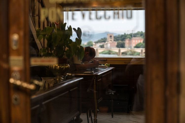 Zoom In. Indoors  Window Home Interior Shop Jewelry Jewelry Store Man People And Places People Photography People Watching People Real People Jewelrydesigner Jewelry Maker Through The Window Firenze Florence Italy Florence Ponte Vecchio Bella Italia Street Photography Italia Italy Detail Streetphotography