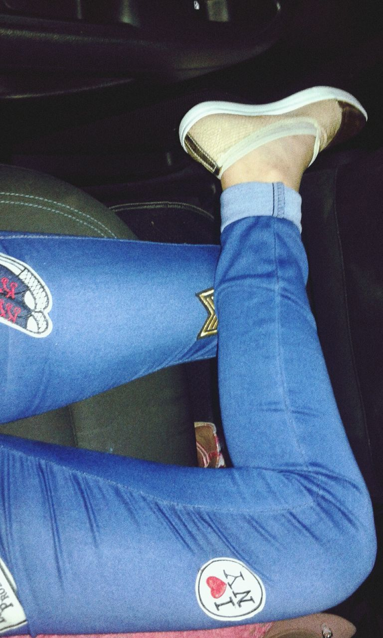 jeans, human leg, low section, one person, real people, blue, sitting, transportation, shoe, casual clothing, indoors, men, human body part, standing, close-up, vehicle seat, day, people
