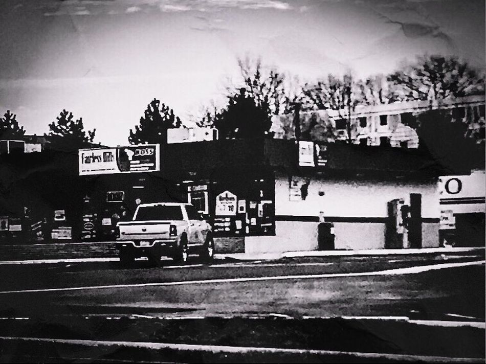 Neighborhood store Placeofbusiness Built Structure Building Exterior Architecture Land Vehicle Day Sky Blackandwhite Photography Camerafilters IPhone7Plus Parking Area