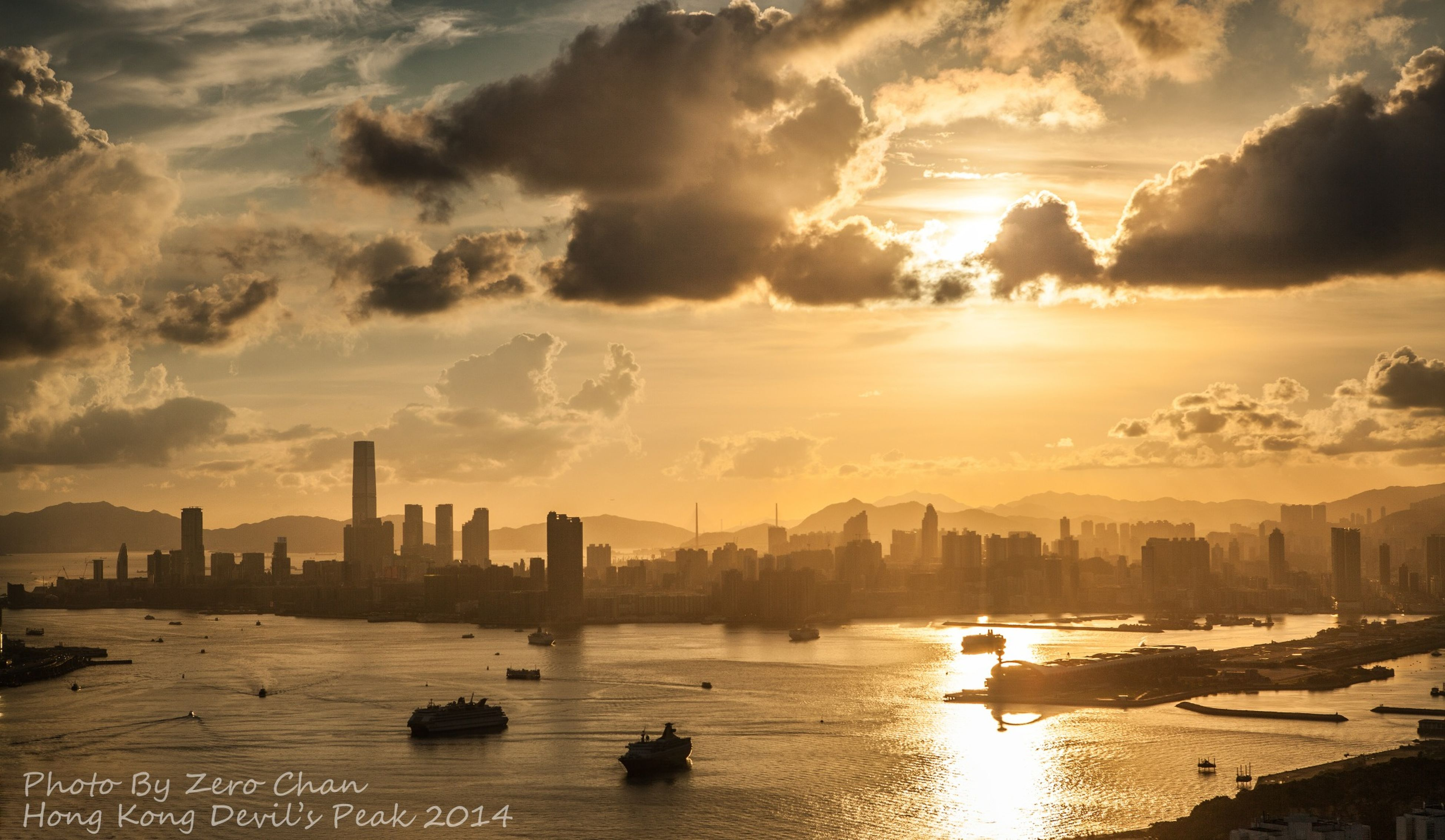 water, city, sunset, architecture, building exterior, built structure, cityscape, waterfront, sky, skyscraper, sea, silhouette, urban skyline, river, cloud - sky, nautical vessel, tall - high, reflection, transportation, tower