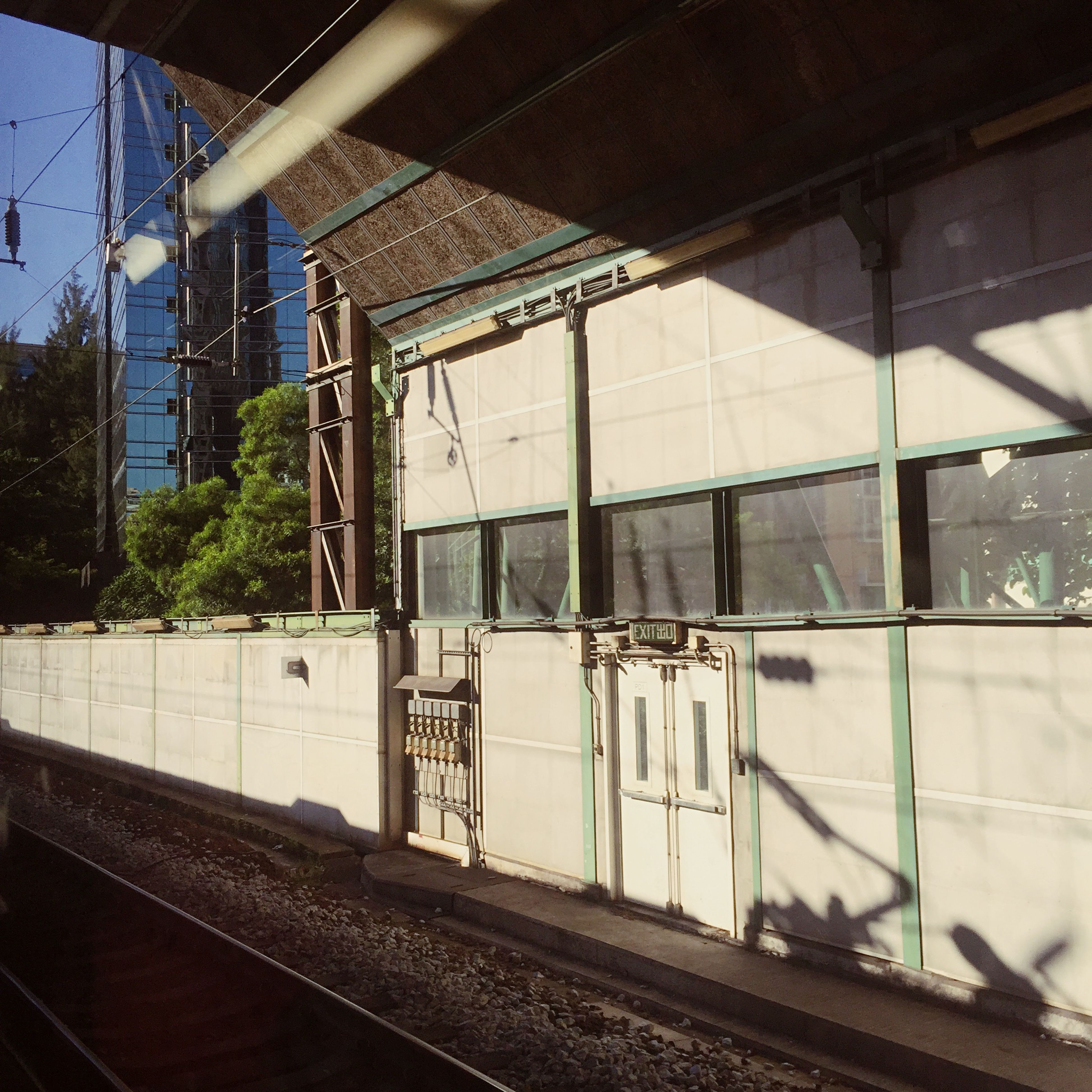railroad track, rail transportation, public transportation, transportation, railroad station platform, built structure, architecture, railroad station, train - vehicle, indoors, building exterior, glass - material, window, train, day, no people, mode of transport, transparent, railway track, passenger train