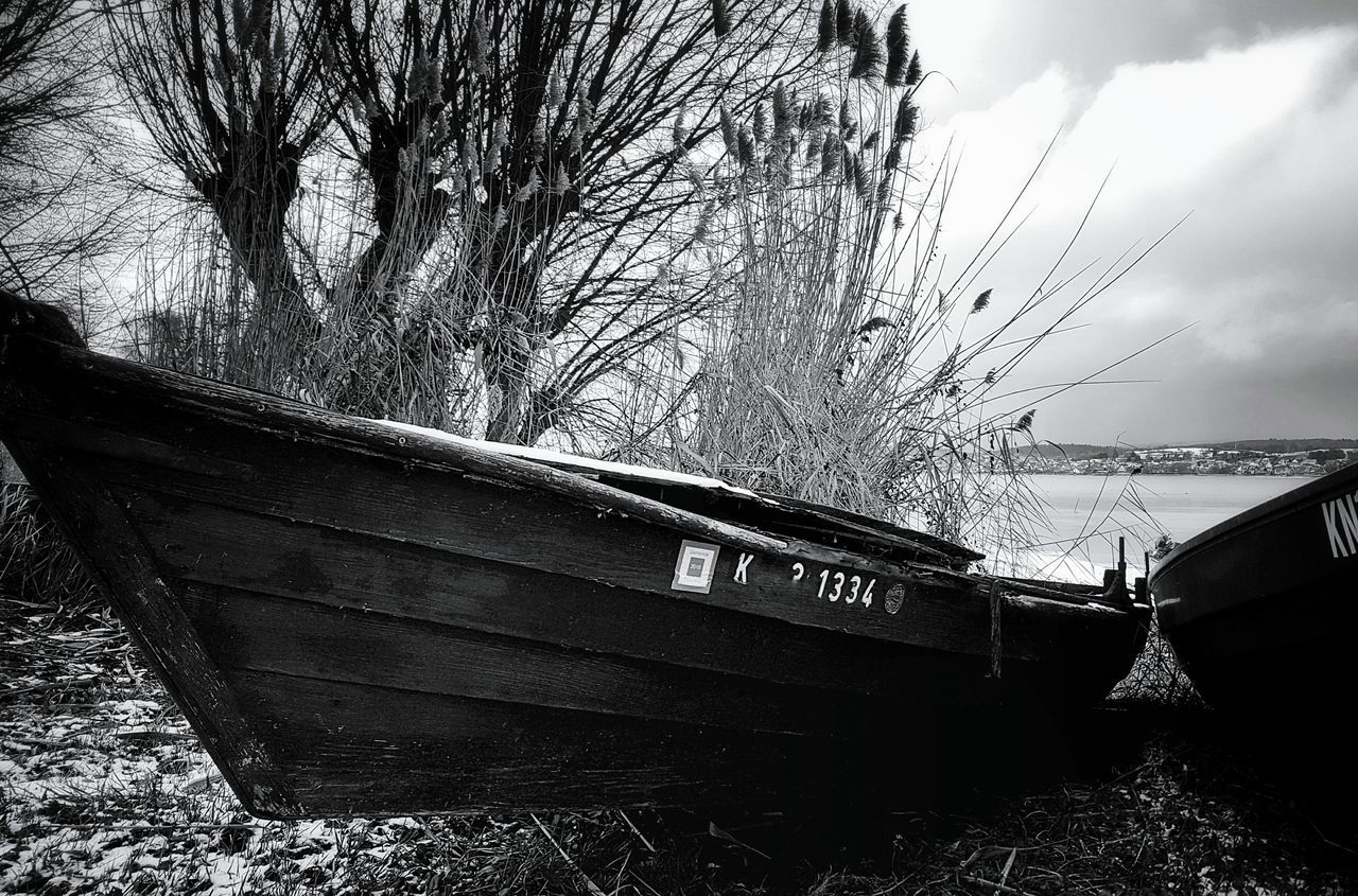Low Angle View No People Outdoors Tree Monochrome _ Collection Snow Frozen Lakeshore Tranquility Cloud - Sky Storm Cloud Landscape_Collection Old Boat Old Boats Ruins Boat Cold Temperature Tranquil Scene Lakescape Black & White Monochrome Collection Winter Landscapes Monochrome Photograhy Lake Constance Scenics