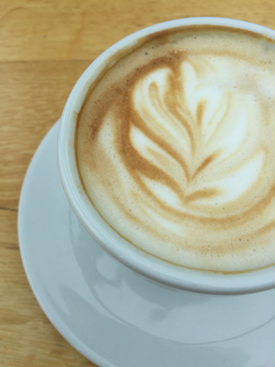 coffee cup, coffee - drink, drink, frothy drink, refreshment, food and drink, froth art, cappuccino, saucer, table, still life, design, latte, close-up, freshness, foam, no people, indoors, high angle view, pattern, healthy eating, day, mocha